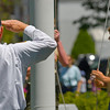 Lowering the Flag -<br /> A veteran salutes the flag as it's lowered to half-staff.