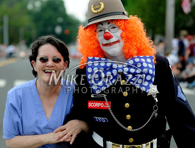 5/28/2011 Mike Orazzi | Staff Lynn Barnes with Scorpio The Clown during the Newington Memorial Day parade on Saturday.