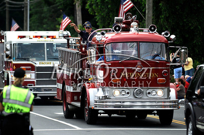 5/28/2011 Mike Orazzi | Staff Members of the Newington Volunteer Fire Department during the Newington Memorial Day parade on Saturday.
