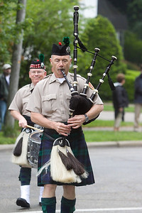 Bagpiper Tom Murphy of DeKalb with DeKalb Fire's Highland Honor Guard at the Ellwood House in DeKalb, Ill. during a Memorial Day observance on Monday, May 27, 2013.