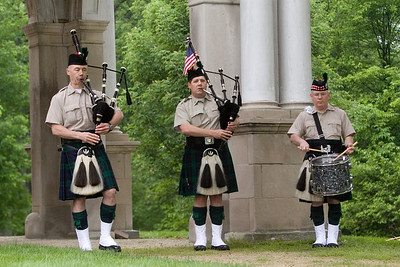 Bagpipers Tom Murphy, left, and Eric Blanken, both of DeKalb, and drummer Gene Vanden Bosch with DeKalb Fire's Highland Honor Guard at the Ellwood House in DeKalb, Ill. during a Memorial Day observance on Monday, May 27, 2013.