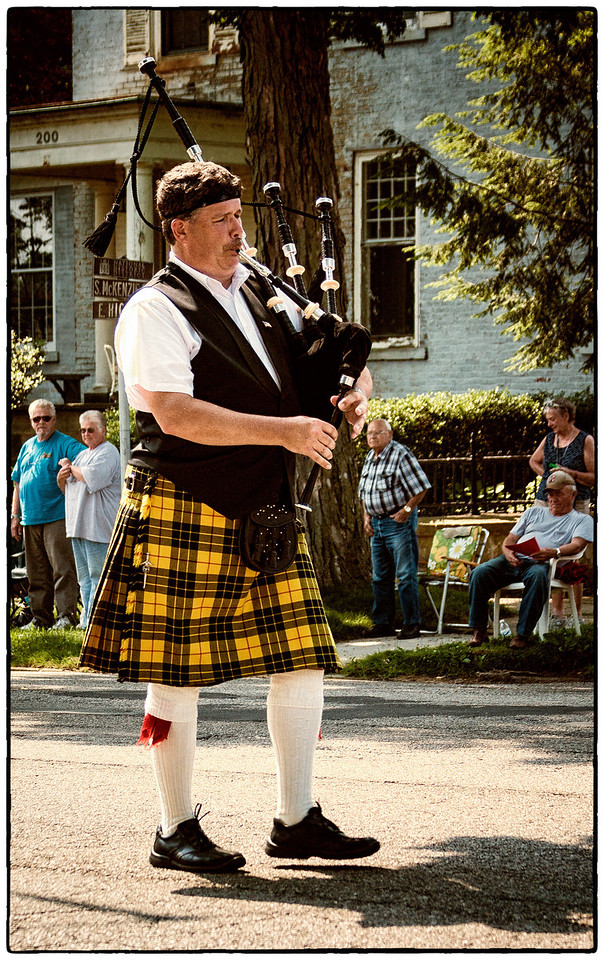 Bagpipes player in Memorial Day parade on East High Street in Mount Vernon, Ohio. Date: May 28, 2012