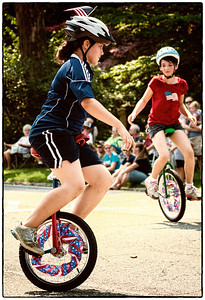 Unicycle riders in Memorial Day parade on East High Street in Mount Vernon, Ohio. Date: May 28, 2012