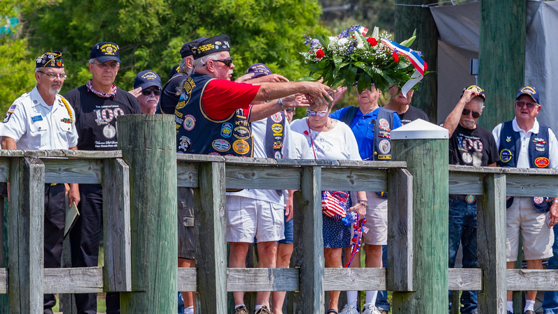 At the close of the Memorial Day remembrance ceremony, members of the Florida chapter of the United States Submarine Veterans tossed the memorial wreath into the St. Johns River in memory of fallen comrades. Fran Ruchalski/Palatka Daily News