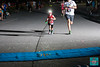 Runners, young and old, brightened the evening at Memorial Park, glowing as they ran 2 miles through the streets of Bentonville.