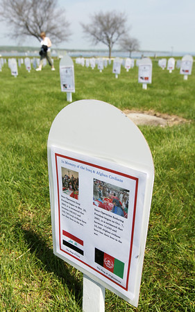 Record-Eagle/Keith King<br /> A marker in memory of Iraq and Afghan civilians is placed into the ground, along with other markers for Michigan servicemen and servicewomen who have been killed in Iraq and Afghanistan, Monday, May 30, 2011 at the Open Space in Traverse City. The markers were placed at the Open Space by the Veterans for Peace Chapter 50.