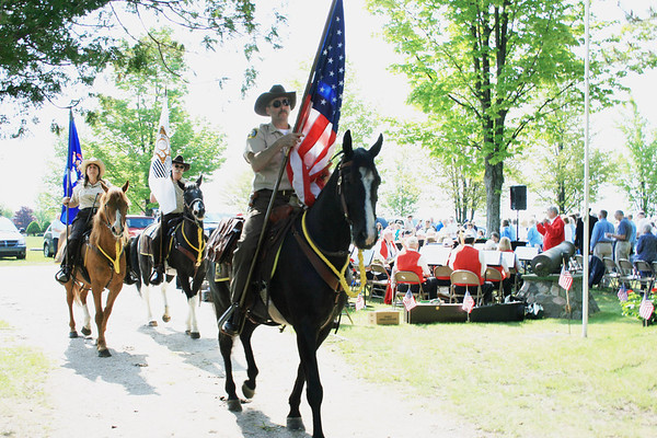 Record-Eagle/Loraine Anderson<br /> The Northport Memorial Day service starts with the procession led by the the Leelanau County Sheriff's mounted patrol.