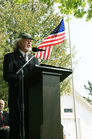 Record-Eagle/Loraine Anderson<br /> Jerry Dennis speaks about the Civil War at Northport's Memorial Day oberservance Leelanau Township Cemetery.