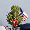 Record-Eagle/Keith King<br /> Paul Waterstradt, of Traverse City, and a United States Marine Corps Veteran, waves to passing motorists while standing in the Patriots Flag Line Monday, May 30, 2011 along Grandview Parkway in Traverse City.