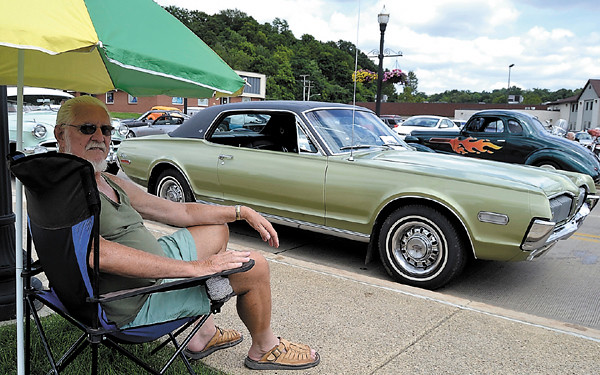Mary Grzebieniak/NEWS<br /> Dave Forrest of Rochester, Pa. exhibits his 1968 Mercury Cougar at yesterday's car show while enjoying some shade.