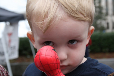 Aiden looking at his Spiderman umbrella.