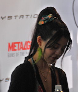 Yumi Kikuchi signing autographs for fans in San Francisco