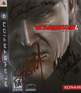 Mr. Kojima, Mr. Imaizumi, and Miss Kikuchi autograph my copy of MGS4.