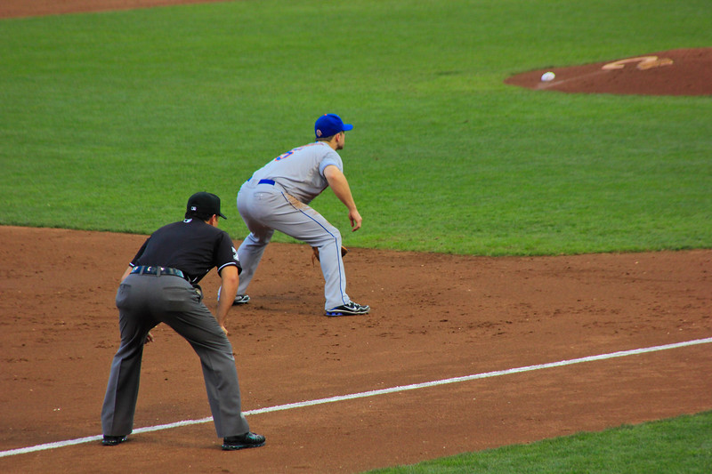 Play Ball!<br /> Wright getting into position for the pitch while the ump looks on.