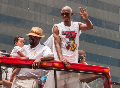 Ray Allen waving, Alonzo Mourning holding baby