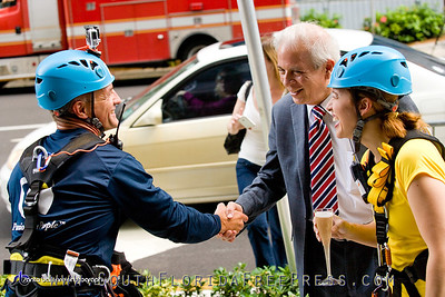 As part of their commitment to give back to the community and support the Miami Children's Initiative,  Mayor Tomas Regalado celebrates the successful landing of Raquel Regalado and Ricky Arriola, on the street-level of the JW Marriot Marquis Miami on Sept. 5, 2013.