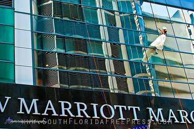 Bride, Rebecca Shackelford, rappels down the JW Marriot Marquis Miami after getting married on the edge of the pool deck on the 19th floor on Sept. 5, 2013. After rappelling, the couple toasted their union with champagne and cake and enjoyed a night's stay at the JW Marriott Marquis Miami, all compliments of the hotel.