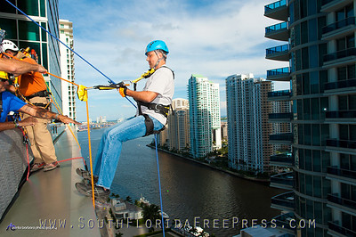 "County Commissioner, Juan C. Zappata, prepares to go ""Over The Edge"" at the JW Marriot Marquis on Sept. 5, 2013 to raise money for children and families in Liberty City."