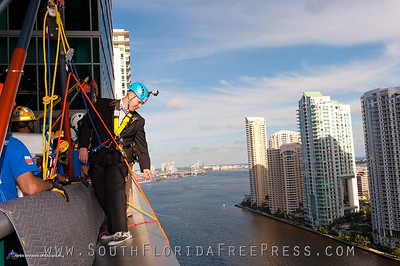 "Groom Carlos Gato, awaits his soon to be bride, Rebecca Shackelford, while taking a look 19 stories down the JW Marriot Marquis Miami, where he later ""took the plunge"" after exchanging vows on the ledge of the pool deck. The couple was the lucky winners of ""Wed Over the Edge"" contest, hosted by Miami Children's Initiative, which works to break the cycle of poverty in Liberty City."