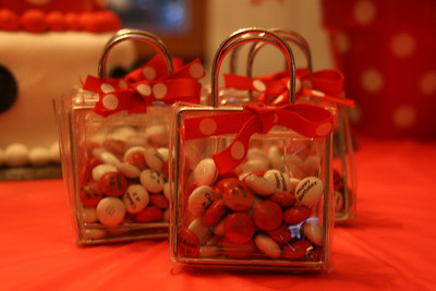 """Adult favors - small purses with red & white M&M's inside.  I had the M&M's personalized to read: """"Happy Birthday!"""" and """"Cibella is 2!"""" on them. http://bellezaeluce.blogspot.com"""
