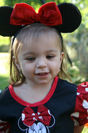 The birthday girl modeling a pair of Minnie ears.  All the girls received Minnie ears and the boys received Mickey ears.  http://bellezaeluce.blogspot.com