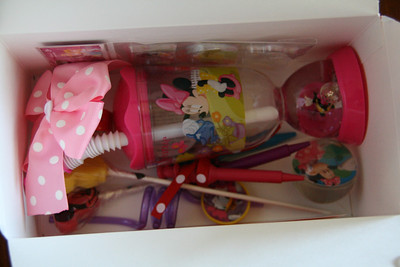 Inside contents for the girls: character shaped crayons, Minnie Mouse cup, stickers, Mickey shaped lollipop, bouncy ball, character silly straw, bubbles, and a pink polka dot hairbow.  They also put the candy and small Mickey & friends characters they got from the pinata in here. http://bellezaeluce.blogspot.com