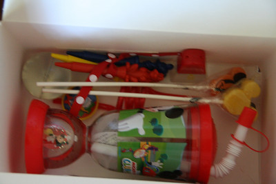 Inside contents for the boys: character shaped crayons, Mickey Mouse Clubhouse cup, stickers, Mickey shaped lollipop, bouncy ball, character silly straw, temporary tattoos, and bubbles.  They also put the candy and small Mickey & friends characters they got from the pinata in here. http://bellezaeluce.blogspot.com