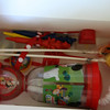 """Inside contents for the boys: character shaped crayons, Mickey Mouse Clubhouse cup, stickers, Mickey shaped lollipop, bouncy ball, character silly straw, temporary tattoos, and bubbles.  They also put the candy and small Mickey & friends characters they got from the pinata in here. <a href=""""http://bellezaeluce.blogspot.com"""">http://bellezaeluce.blogspot.com</a>"""