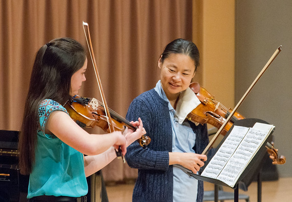 Violin master class student.