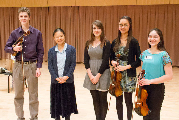 Violin master class students with Midori.