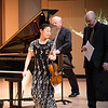 Midori and Özgür Aydin arrive on stage, with their page-turner.   Image courtesy of Dennis Chamberlain.