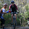 A rider negotiates a log crossing at the first women's clinic.  The clinic was held at Town Run Trail Park in Indianapolis, Indiana in October 2005.