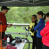 Participants learn how to fix a flat and lube a chain at the May 2006 women's clinic.