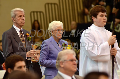 Mike Vogt's parents Mary and Albert Vogt present the gifts during his Ordination in the Gym of Salesianum School, Wilmington, Del., Friday, January 27, 2012. Mike Vogt ask Bishop Malooly for permission to have his Ordination in the gym of Salesianum School where he is a teacher. photo/Don Blake Photography.com