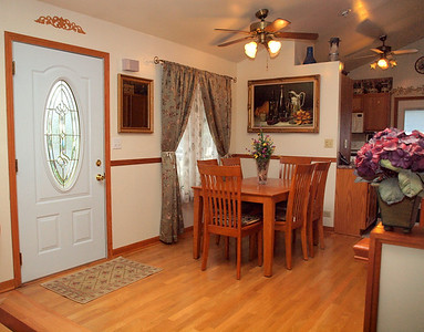 Open dining room with cathedral ceiling & hardwood floors