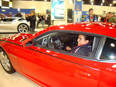 Rigo in his favorite car, the Camero.