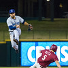 Corpus Christi Hooks infielder Jack Mayfield leaps over a sliding Preston Beck to throw complete a throw to first base in a game agains the Frisco RoughRiders. (Photo by Sam Hodde)