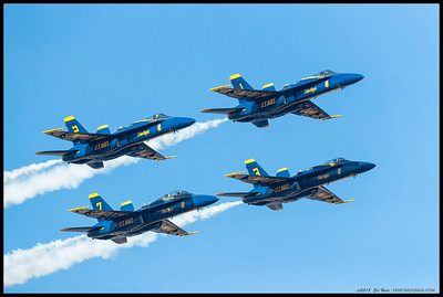 Four of the Blue Angel's F-18 Hornet's flying by in close formation.