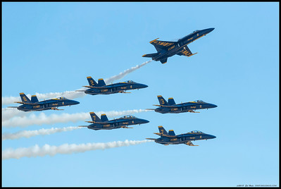 All six of the Blue Angel's demo team flying by as plane 1 climbs out of formation.