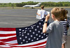 A military plane carrying fallen Soldier Lt. Robert Collins of Tyrone  touches down at Falcon Field Airport in Peachtree City just after noon Thursday.
