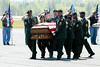 A military plane carrying fallen Soldier Lt. Robert Collins of Tyrone  touches down at Falcon Field Airport in Peachtree City just after noon Thursday. U. S. Army Honor Guard.