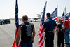 A military plane carrying fallen soldier Lt. Robert Collins of Tyrone  touches down at Falcon Field Airport in Peachtree City just after noon Thursday. The Patriot Guard Riders of Georgia provide an honor guard and escort for the funeral procession.