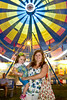 August 24, 2012. The 2012 Fayette Fayette County Fair. Hannah Buswell, Fayetteville, GA and her daughter Mimi, pose in front of the ferris wheel.