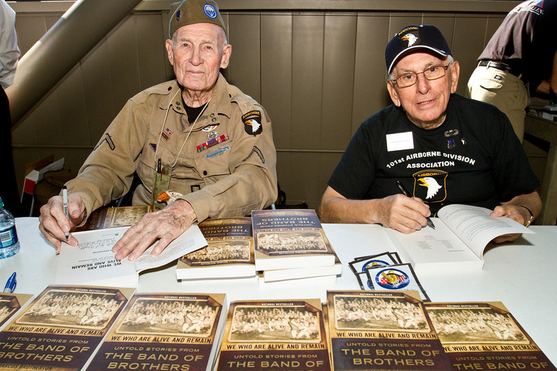 """Ed """"Doc"""" Pepping (L) and Al Mampre (R) signed copies of the book, """"Band of Brothers"""" which features stories about their experiences."""