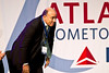 The Coca-Cola Company's CEO Muhtar Kent rises to meet Richard Anderson.