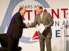 The Coca-Cola Company's CEO Muhtar Kent shakes hands with Richard Anderson.