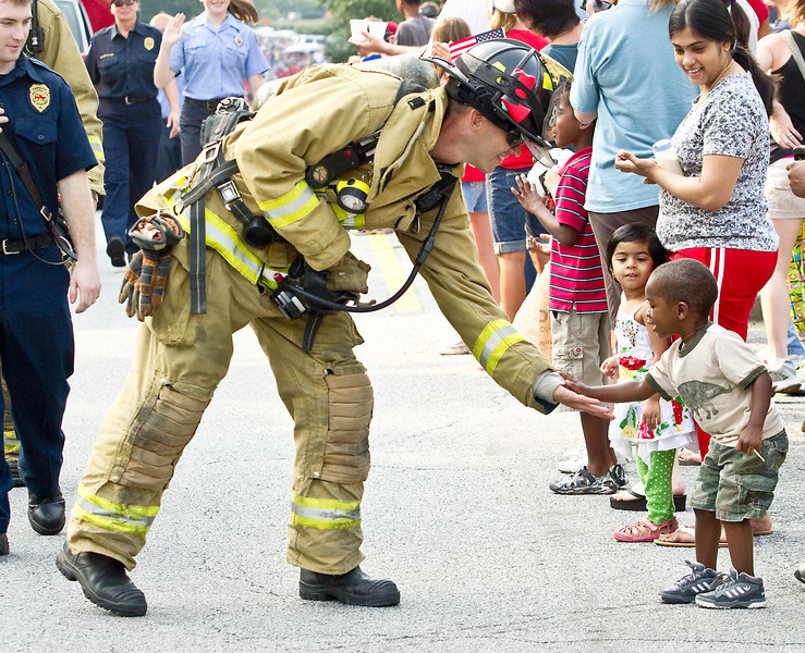 Peachtree City Fireman Robby Shelton shakes hands with a young admirer.