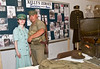 "Brittany (L) and Jami Grulla of Dawsonville, both members of Kelly's Zeroes,a historical reenacting organization, pose for a photo at the group's display.  <a href=""http://www.kellyszeroes.com"">http://www.kellyszeroes.com</a>"