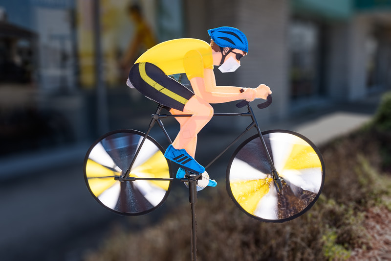 The bicycle spinner photo with his face mask was taken by Arnold Dubin