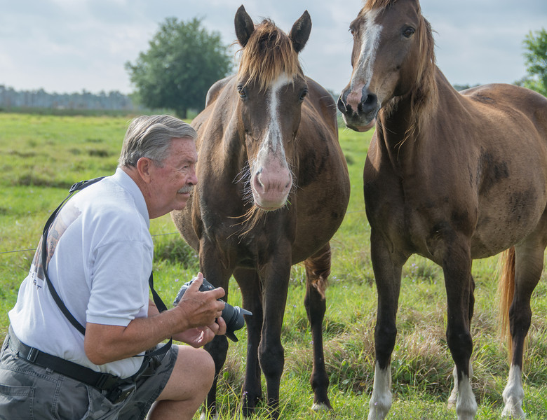 Ed getting up close to become friends with the 2 Florida Cracker Horses